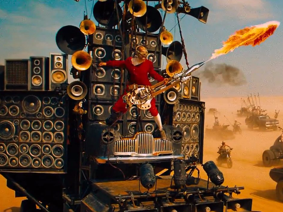 the-man-behind-the-awesome-flamethrower-guitar-player-in-mad-max-fury-road-is-a-popular-australian-musician.jpg